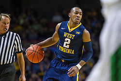 Dec 17, 2015; Charleston, WV, USA; West Virginia Mountaineers guard Jevon Carter (2) dribbles the ball during the first half against the Marshall Thundering Herd at the Charleston Civic Center . Mandatory Credit: Ben Queen-USA TODAY Sports