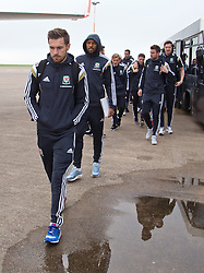 CARDIFF, WALES - Saturday, November 15, 2014: Wales' Aaron Ramsey and the squad arrive at Cardiff Airport for their flight to Brussels ahead of the UEFA Euro 2016 Qualifying Group B game against Belgium. (Pic by David Rawcliffe/Propaganda)