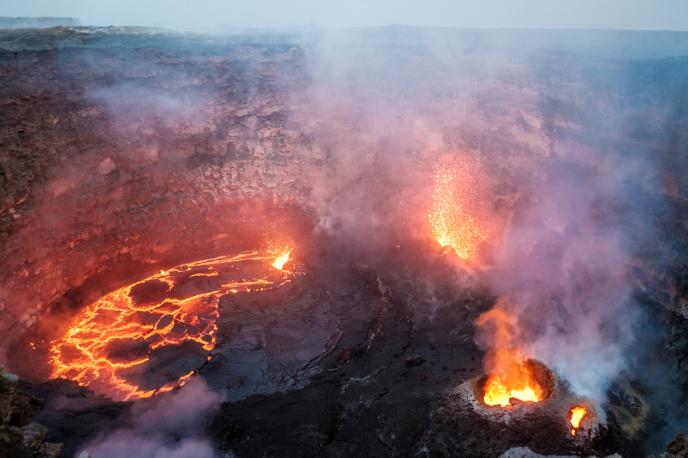 Erta Ale volcano at first light. Erta Ale is the most active volcano in Ethiopia. It's a continuously active basaltic shield volcano in the Afar Region of northeastern Ethiopia, situated in the Afar Depression, a badland desert area.