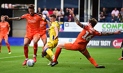Ollie Clarke of Bristol Rovers battles for the ball with Glen Rea of Luton Town and Sonny Bradley of Luton Town - Mandatory by-line: Alex James/JMP - 15/09/2018 - FOOTBALL - Kenilworth Road - Luton, England - Luton Town v Bristol Rovers - Sky Bet League One