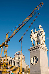 Historic statue on Palace Bridge beside construction site of new Berlin Palace, (Schloss)  in Mitte Berlin Germany