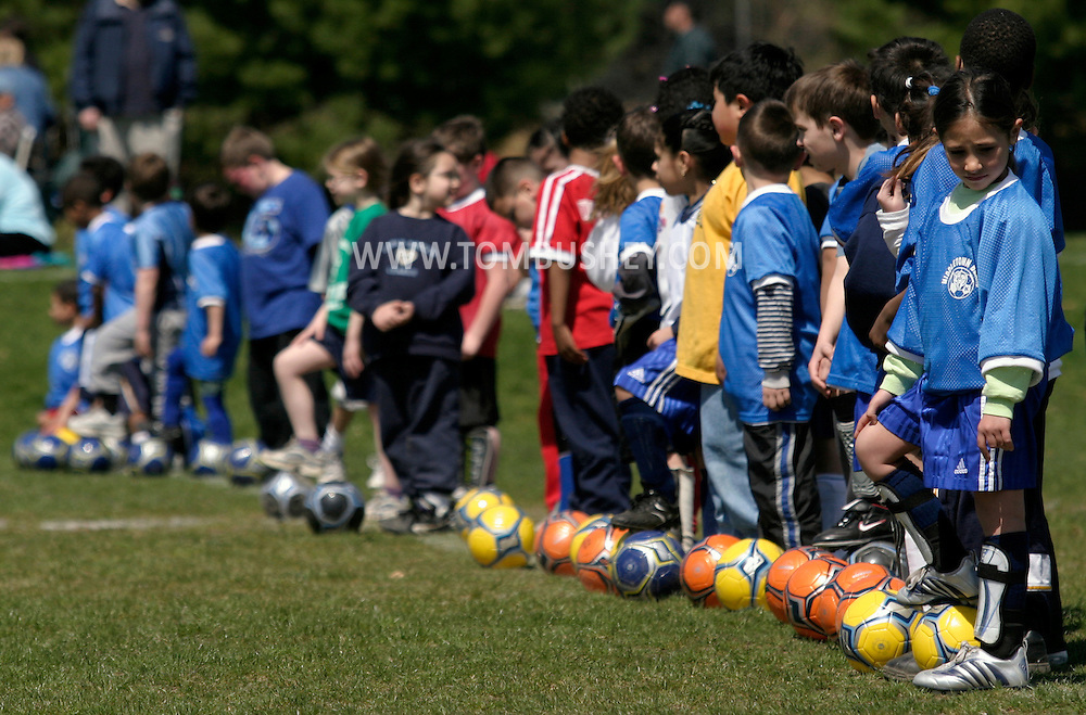 Boys and girls line up for the first day of youth soccer practice at Watts Park in Middletown, N.Y. The players are first graders and second graders.April 16, 2005.