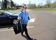 LEVITTOWN, PA - APRIL 26:  Social Worker Jennifer Dombroski, of Bristol Township, Pennsylvania collects prescription drugs during a drug take back at the Bucks County Library Levittown Branch April 26, 2014 in Levittown, Pennsylvania. (Photo by William Thomas Cain/Cain Images)