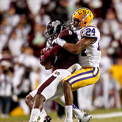 November 10, 2012; Baton Rouge, LA, USA; LSU Tigers cornerback Tharold Simon (24) tackles Mississippi State Bulldogs wide receiver Chris Smith (8) during the first half of a game at Tiger Stadium.  Mandatory Credit: Derick E. Hingle-US PRESSWIRE