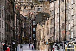 Edinburgh, Scotland, UK. 18 April 2020. Views of empty streets and members of the public outside on another Saturday during the coronavirus lockdown in Edinburgh. People on the Royal Mile. Iain Masterton/Alamy Live News
