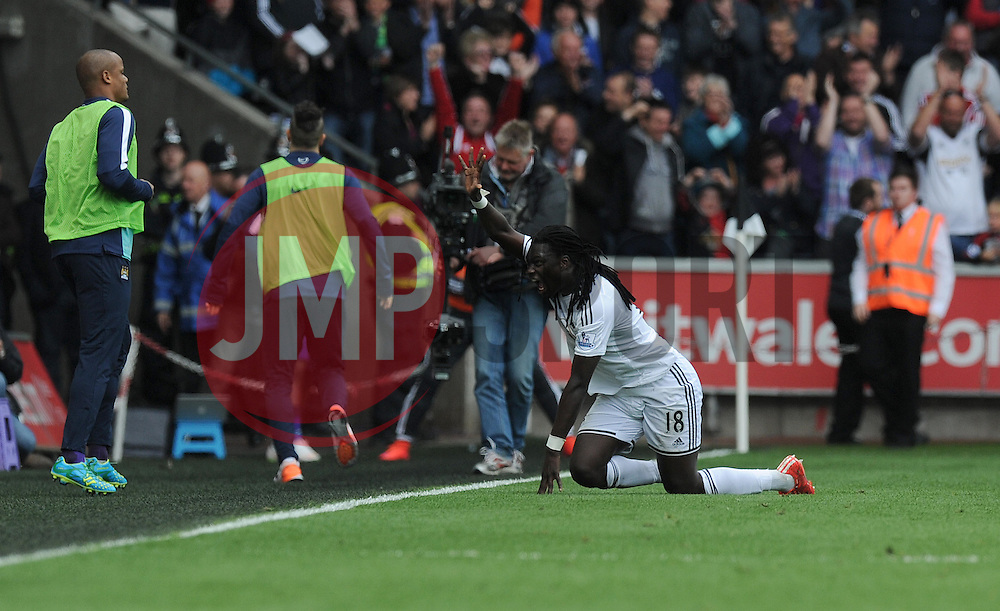Swansea City's Bafetibis Gomis celebrates. - Photo mandatory by-line: Alex James/JMP - Mobile: 07966 386802 - 17/05/2015 - SPORT - Football - Swansea - The Liberty stadium - Swansea City v Manchester City - Barclays premier league