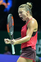 SINGAPORE, Oct. 23, 2017  Simona Halep of Romania reacts during the group match against Caroline Garcia of France at WTA Finals tennis tournament in Singapore, Oct. 23, 2017. (Credit Image: © Then Chih Wey/Xinhua via ZUMA Wire)