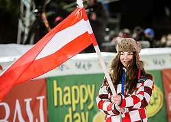 """Hostess with an Austrian flag due to the win of Marcel Hirscher (AUT) at Trophy ceremony after the 2nd Run of FIS Alpine Ski World Cup 2017/18 Men's Slalom race named """"Snow Queen Trophy 2018"""", on January 4, 2018 in Course Crveni Spust at Sljeme hill, Zagreb, Croatia. Photo by Vid Ponikvar / Sportida"""