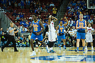 19 MAR 2015: Issac Hamilton (10) of the University of California Los Angeles celebrates clinching their win against Southern Methodist University takes on the  during the 2015 NCAA Men's Basketball Tournament held at the KFC Yum! Center in Louisville, KY. UCLA defeated SMU 60-59. Brett Wilhelm/NCAA Photos