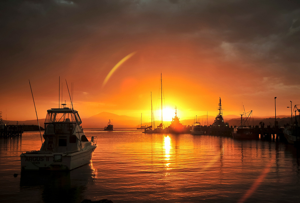 A beautiful sunset over the waters of Eden in Australia.