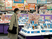 costumer looking at new digital gadgets in electronic store Akihabara Tokyo