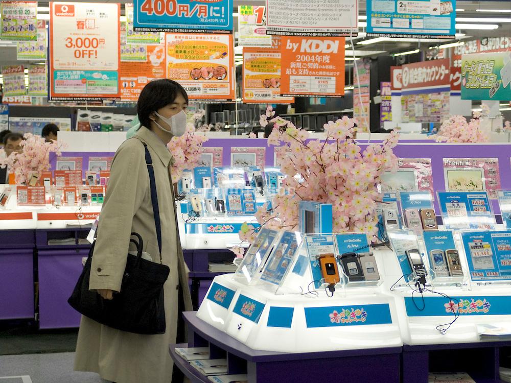costumer looking at new digital gadgets in electronic store Akihabara Tokyo