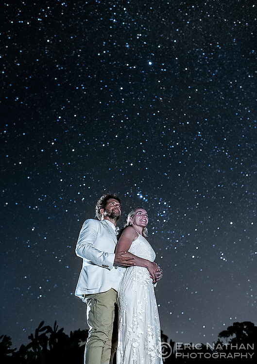 Wedding couple pose under the stars.