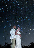 Wedding couple pose under the stars.