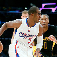 31 October 2014: Los Angeles Clippers guard Chris Paul (3) drives past Los Angeles Lakers forward Wesley Johnson (11) during the Los Angeles Clippers 118-111 victory over the Los Angeles Lakers, at the Staples Center, Los Angeles, California, USA.