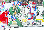 LONDON,ON - MARCH 27:  Connor Bunnaman #74 of the Kitchener Rangers waits for a puck to tip at Tyler Parsons #1 of the London Knights during Game One of the OHL Western Conference Quarter-Finals at Budweiser Gardens on March 27, 2015 in London, Ontario, Canada. The Knights defeated the Rangers 3-1 to take a 1-0 series lead. (Photo by Claus Andersen/Getty Images)