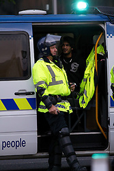 © Licensed to London News Pictures. 09/08/2011. Manchester, UK. Destruction and looting  across the city centre by gangs. Shops are smashed, looted. A man is arrested after being caught looting in Footasylum in the Arndale Centre. Photo credit : Joel Goodman/LNP