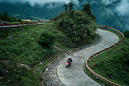 Man rides a winding road in Mau Son, Vietnam, Southeast Asia