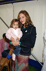 TRINNY WOODALL and her daughter LYLA ELICHAOFF at the 3rd annual Macmillan Dog Day in aid of Macmillan Cancer Relief held at Royal Hospital Chelsea, London SW3 on 5th July 2005.<br />