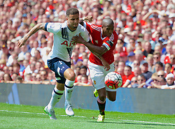 MANCHESTER, ENGLAND - Saturday, August 8, 2015: Manchester United's Ashley Young in action against Tottenham Hotspur's Kyle Walker during the Premier League match at Old Trafford. (Pic by David Rawcliffe/Propaganda)