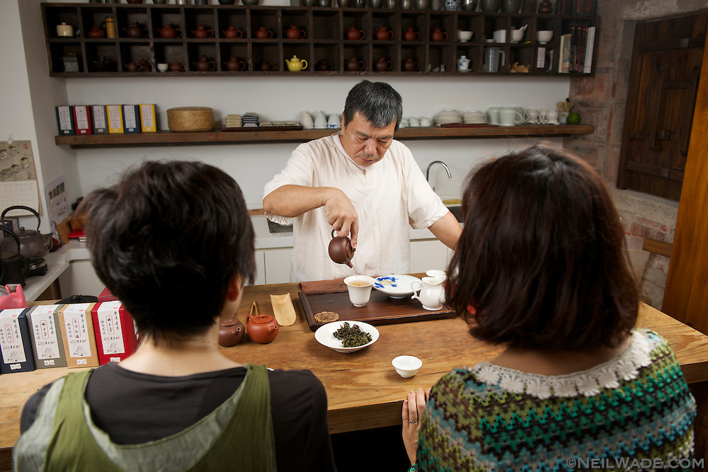 Lu Li-Hsien serves tea in Chen Wey Tea Room, on Dihua Street.