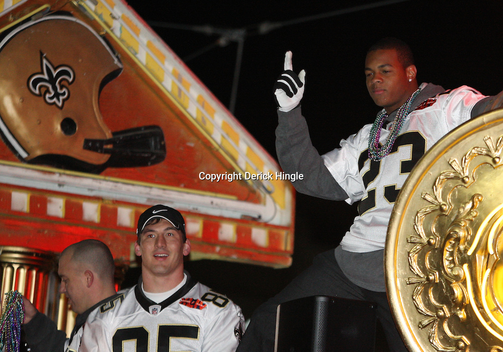 Feb 09, 2010; New Orleans, LA, USA; New Orleans Saints running back Pierre Thomas (23) and tight end David Thomas (85) ride a float during the Super Bowl celebration parade for the New Orleans Saints 31-17 victory over the Indianapolis Colts in Super Bowl XLIV as the parade passed through the downtown streets of New Orleans, Louisiana.  Mandatory Credit: Derick E. Hingle-US-PRESSWIRE.