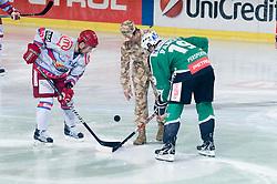 First face off with Slovene soldier during ice-hockey match between HDD Tilia Olimpija and HK Acroni Jesenice in 41st Round of EBEL league, on Januar 23, 2011 at Hala Tivoli, Ljubljana, Slovenia. (Photo By Matic Klansek Velej / Sportida.com)