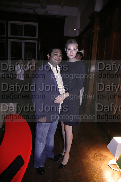 Angad Paul and Michelle Paul, Established and Sons celebrate the launch of a Red Production 'Aqua Table' by Zaha Hadid. ( Profits from Sales will go to Red Campaign HIV treatment in Africa) Grosvenor Place. London. 23 September 2006.  ONE TIME USE ONLY - DO NOT ARCHIVE  © Copyright Photograph by Dafydd Jones 66 Stockwell Park Rd. London SW9 0DA Tel 020 7733 0108 www.dafjones.com