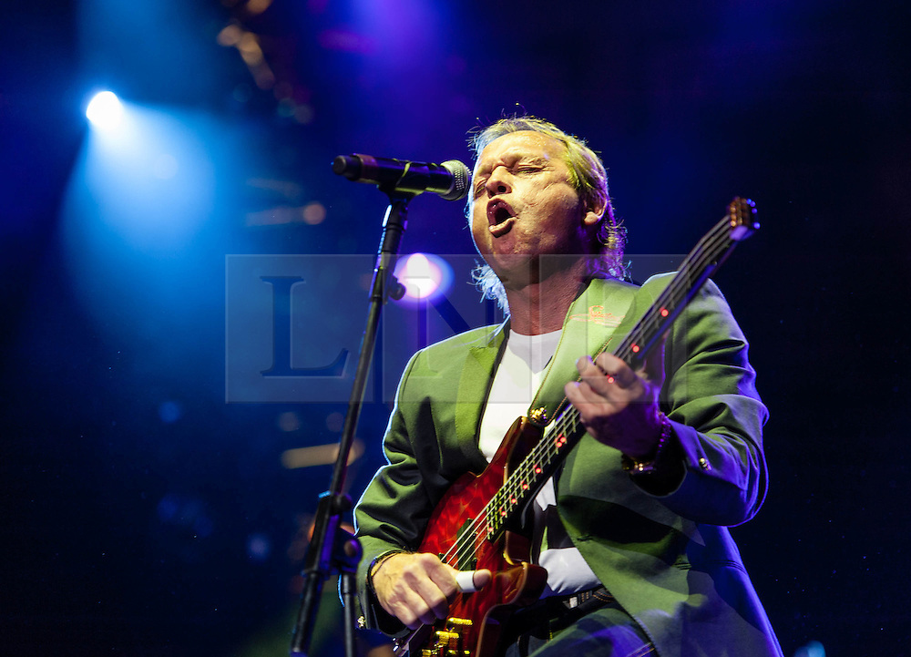 "© Licensed to London News Pictures. 16/09/2012. London, UK.  Mark King performs at The Sunflower Jam at the Royal Albert Hall.  Mark King is the lead singer and bassist of Level 42.  The Sunflower Jam is a British charity, founded by Jacky Paice, wife of Deep Purple drummer, Ian Paice. Other high-profile supporters are the actor Jeremy Irons, ex-Jamiroquai bassist Nick Fyffe and Charles, Prince of Wales. The aims of the charity are to fund complementary therapists and spiritual healers to work on cancer wards in the British National Health Service. After setting up a meeting between members of Deep Purple and a young boy dying of leukemia, Paice saw ""all the good work the healers were doing"" and decided ""lets find a way to raise money to get more healers in there. Photo credit : Richard Isaac/LNP"