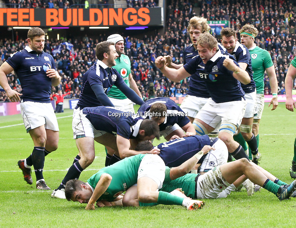 February 4th 2017, Murrayfield, Edinburgh, Scotland; 6 Nations International rugby, Scotland versus Ireland;  Scotlands centre Alex Dunbar is congratulated on his try by team-mates Greig Laidlaw Jonny Gray and Jonny Gray