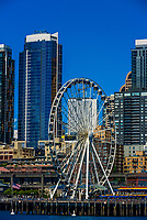 The Seattle Great Wheel (ferris wheel) highlights the waterfront with the skyscrapers of Downtown Seattle behind, Washington State USA.