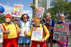 """© Licensed to London News Pictures. 20/07/2019. London, UK.  A protester wearing Conservative Party leadership contender BORIS JOHNSON (C) face mask as Pro EU demonstrators take part in the """"No to Boris. Yes to Europe"""" march in central London. Photo credit: Dinendra Haria/LNP"""