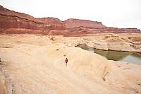 Young man hiking in Glen Canyon National Recreation Area, Utah.