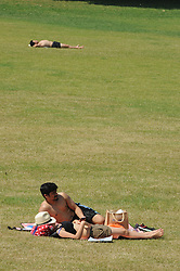 © Licensed to London News Pictures. 18/07/2014<br /> People enjoying the heatwave weather at Greenwich Park,Greenwich,London.<br /> (Byline:Grant Falvey/LNP)