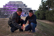 Wilson Romero Tojín De León (left), 20, and Gaspar Hernández Mendoza, 18, both soldiers in the 5th Infantry Brigade, stationed in Mariscal Gregorio Solares base, Huehuetenango, light up candles previous to the celebrations marking the end of the Mayan Era known as 13 Baktun. Zaculeu, Huehuetenango, Guatemala. December 20, 2012.