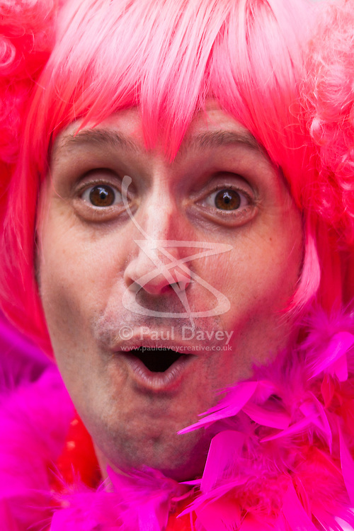 London, June 28th 2014. Feathers and wigs as the Pride London parade proceeds through the city's streets.