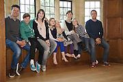 The Elliott and Baker families in the ballroom at Pickwell Manor. From left to right: Steve Baker, Zac Baker (11), Susannah Baker, Liza Baker (9), Millie-grace Elliott (8), Tracey Elliott,  Molly Elliott (10), Richard Eliott. Pickwell Manor, Georgeham, North Devon, UK.<br /> CREDIT: Vanessa Berberian for The Wall Street Journal<br /> HOUSESHARE