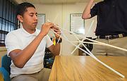 Senior Osmar Barrera works on a straw bridge during a summer intern program with FH-HP at Washington High School, June 16, 2014.