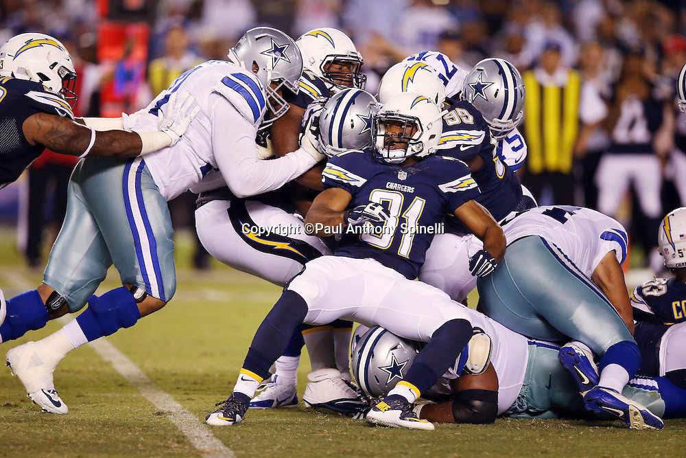 Dallas Cowboys running back Gus Johnson (37) gets gang tackled by San Diego Chargers defensive back Adrian Phillips (31) and San Diego Chargers linebacker Cordarro Law (99) as he runs the ball in the third quarter during the 2015 NFL preseason football game against the San Diego Chargers on Thursday, Aug. 13, 2015 in San Diego. The Chargers won the game 17-7. (©Paul Anthony Spinelli)