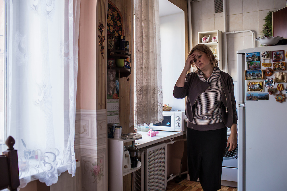 Inessa Rozova, Alexander Panin's mother, inside Panin's grandmother's apartment where he was mostly raised on Tuesday, February 25, 2014 in Tver, Russia. Panin, a Russian citizen who was arrested in the Dominican Republic in June 2013, is set to be charged by federal authorities in the US with being part of a gang which robbed bank accounts via the Internet. Photo by Brendan Hoffman, Freelance