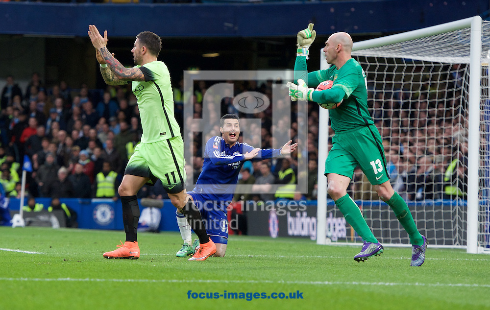 Pedro of Chelsea appeals for handball while Aleksandar Kolarov of Manchester City and goalkeeper Wilfredo Caballero disagree during the FA Cup match at Stamford Bridge, London<br /> Picture by Alan Stanford/Focus Images Ltd +44 7915 056117<br /> 21/02/2016