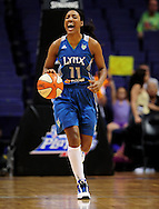 Sep 25, 2011; Phoenix, AZ, USA; Minnesota Lynx guard Candice Wiggins (11) handles the ball against the Phoenix Mercury during the first half at the US Airways Center. The Lynx defeated the Mercury 103-86. Mandatory Credit: Jennifer Stewart-US PRESSWIRE