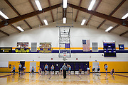 03/19/2014- Stevens Point, Wisc. - The women's basketball team warms up before their first practice at Berg Gym before NCAA Division III Women's Final Four on Mar. 19, 2014. (Kelvin Ma/Tufts University)