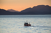 A commercial fishing boat makes its way through Aysen Fjord, Chile.