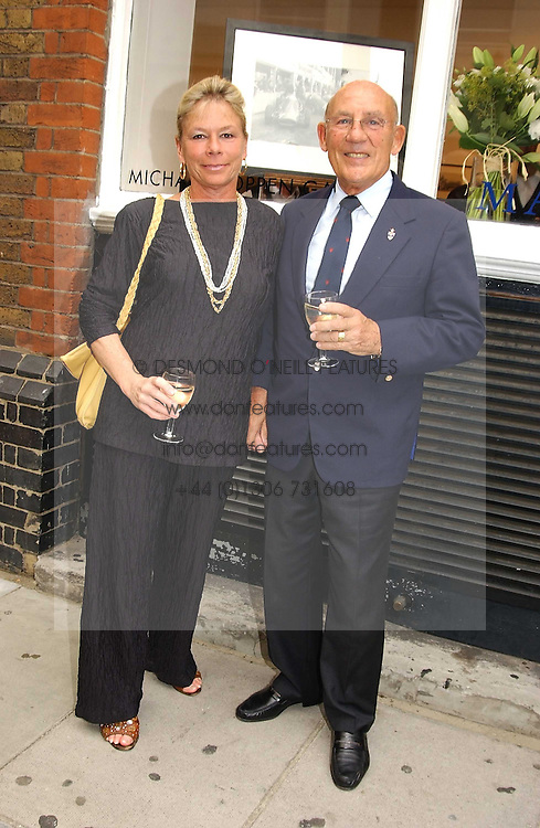 SIR STIRLING & LADY MOSS at an exhibition of photographs featuring Maserati cars held at the Michael Hoppen Gallery, 3 Jubilee Place, London SW3 on 13th July 2005.<br />