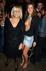 Left to right, JANET REGER and RUTH GIBBON at a party to celebrate a new collection of sexy underware by Janet Reger called 'Naughty Janet' held at 5 Cavendish Square, London on 19th October 2004.<br />