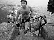 A competitor leaving the water after competing in an open sea swim. Sandycove, Co. Dublin, Ireland, June 2005.