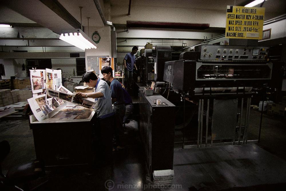Printing the book Material World: A global family portrait; a press check. Hong Kong (Quarry Bay) Mandarin/ Topan.