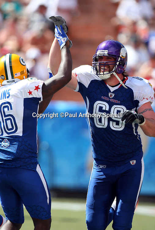 HONOLULU, HI - FEBRUARY 08: NFC All-Stars defensive end Jared Allen #69 of the Minnesota Vikings celebrates with teammates after stripping and recovering a fumble by the AFC All-Stars in the 2009 NFL Pro Bowl at Aloha Stadium on February 8, 2009 in Honolulu, Hawaii. The NFC defeated the AFC 30-21. ©Paul Anthony Spinelli *** Local Caption *** Jared Allen