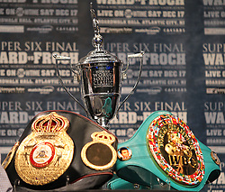 Dec 13; New York, NY, USA; Andre Ward's WBA Super Middleweight belt (left) and Carl Froch's WBC Super Middleweight belt (right) sit alongside the Super Six trophy at the final press conference for their fight.  The two will meet at Boardwalk Hall in Atlantic City, NJ on Saturday, December 17, 2011.